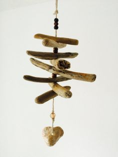 Driftwood mobile hanging decoration with heart shaped shell detail