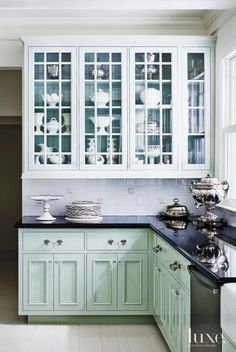 A Coat Of High Gloss Oil Benjamin Moore Paint In Turquoise Mist, A Color  Inspired By The Paris Tea Salon Ladurée, Transformed The Kitchen Cabinetry,  ...
