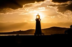 Bassin Lighthouse on Iles de la Madeleine last evening before some nasty rain clouds covered the Island. Happy Lights, Lighthouse Art, Rain Clouds, Lake Geneva, Sardinia, Crete, Croatia, Belgium, Statue Of Liberty