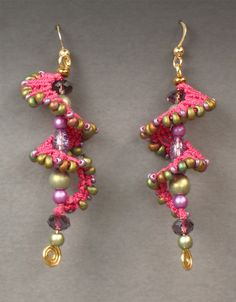 """""""Galaxy"""" earrings in fuchsia, greens and purples. Gold-filled ear wires. Approx. 2.75"""" Long."""