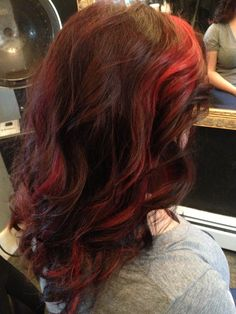 Dark auburn with red high lights. Long hair beach waves. Layers   by tracey