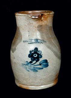 "Price Realized: $ 345.00 One-Gallon Stoneware Pitcher with Unusual Floral Decoration, Stamped ""COWDEN & WILCOX / HARRISBURG, PA,"" circa 1865, ovoid pitcher with rounded foot and flared collar, decorated with a brushed cobalt daisy"