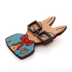 This cute little brooch is made from laser cut wood, hand painted outfit and perspex glasses