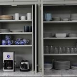 Coffee makers, mixers, toasters — they can be quite lovely appliances, but in addition to everything else on your counter, they take up a lot of physical and visual space. An appliance garage can store these everyday appliances, without them having to be moved each time you want to use them. An appliance garage can fit seamlessly into your kitchen design through a flip-up hatch or bi-parting cabinet doors, and even double as a coffee bar or even a wine station. Here are a few of our favorite…