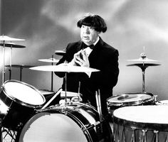 Alfred Hitchcock impersonating Ringo Starr, 1964.