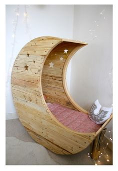Cot created from salvaged wood from old pallets. Designed by Jocelyn Costis from Creme Anglaise.