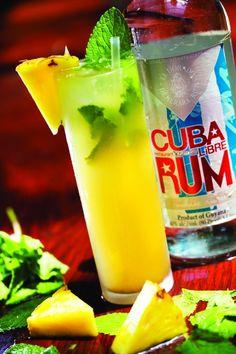 Grilled Pineapple Mojito (1.25 oz. White Rum 2 tsp. Pineapple Puree 2.5 oz  simple syrup 1.25 oz. Fresh Lime Juice 6 each mint 1 splash Lemon-lime soda Garnish Pineapple wedge)