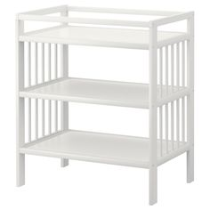Nursery: GULLIVER Changing table from IKEA. Store nappies etc in baskets. Use after for toy storage?