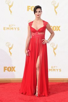 Pin for Later: Your Favorite Latinas Stole the Emmys Red Carpet With Their Sexy Gowns Morena Baccarin This bright scarlet dress was the perfect match for the Brazilian actress, there to celebrate her show Homeland.