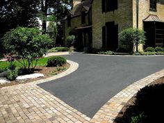 Driveway Patios and Walkways | Landscape plantings with paver driveway apron and border