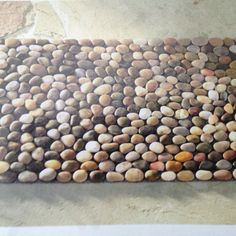 Fire place ideas on pinterest stone fireplaces mosaic for River stone mat