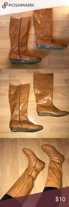 Tan Knee-High Boots Tan knee-high boots with slight heel. Minor tear shown. Size 6 but fits more like a 6.5. Barely worn. Old Navy Shoes Heeled Boots