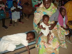 amilies at Kalma Camp, South Darfur in clinic waiting area. 2009
