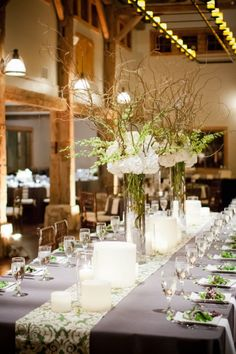 tall center pieces with the bulk (flowers) way above face level so you don't have to push through the jungle to talk to the person seated across from you ~