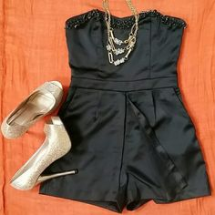 """NWT Forever 21 Black Strapless Romper Size S New With Tag Super Pretty Black Strapless Romper from Forever 21.  24"""" Length,  26-27"""" Waist,  30 Bust. Shell 98% Polyester / 2% Spandex Lining 100% Polyester *** PRICE FIRM *** ??? Available in Size M also ??? Size M ( L- 24"""", W- 28-29"""", B- 34"""") Forever 21  Dresses Strapless"""