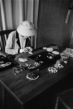 Gabrielle Coco Chanel - Coco Chanel at work with pearls.jpg