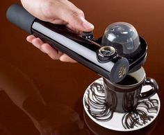 Handpresso! The hand held gadget needs no electricity. It uses ESE (easy serve espresso) pods & requires hot water. From there, you pump the handle to manually build up enough pressure to pull a shot. Very convenient & while perhaps not quite up to the standards of a 1,000 dollar machine, it's definitely something for a space-pressed coffee fan to consider keeping on hand.