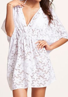 V Neckline Cover Up - White. The perfect cover-up for sunny days by the pool, or an easy layering piece for evenings on the town, this white lace dress features a elastic waist and a deep V-neckline.