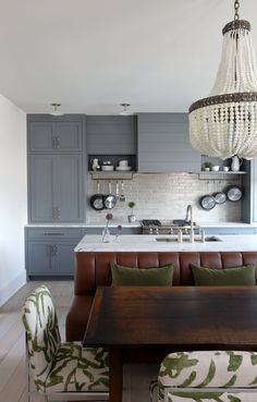 Room Envy: This cozy kitchen moves the refrigerator and small appliances out of view Banquette Dining, White Oak Floors, Cozy Kitchen, Kitchen Ideas, Vintage Chairs, Small Appliances, Wooden Tables, Countertops, Building A House