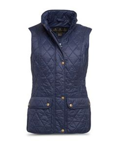 The Barbour Otterburn Gilet is a diamond-quilted design featuring curved side hems and deep patch pockets with stud-close flaps. Side-waist tabs allow the classic fit to be adjusted for more definition or to accommodate layers, while tonal binding adds a African Women, African Fashion, Ankara Fashion, African Style, Barbour Women, Country Attire, Types Of Jackets