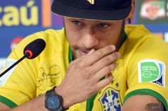 Brazil's forward Neymar cries during a press conference in Teresopolis on July 10, 2014, during the FIFA World Cup. Brazil will face Netherlands on July 12, in the third place play-off for the FIFA World Cup tournament at The Mané Garrincha National Stadium in Brasilia.