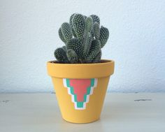 A personal favorite from my Etsy shop https://www.etsy.com/listing/269427014/4-terra-cotta-cactus-pot-hand-painted