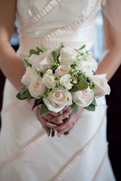 White roses bouquet.  I like how it is sort of loose and not like a tight wound up ball of roses.