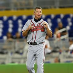 Chipper Jones #10 of the Atlanta Braves looks on during a game against the Miami Marlins