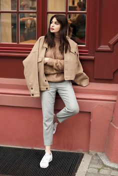 If you're looking for some fresh inspiration on how to wear your grey pants for fall and winter look no further than this chic inspiration from Laura Matuszczyk of the blog Horkruks.