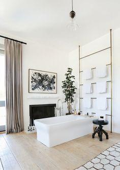 BECKI OWENS--Designer Spotlight: Alexander Design. Love the brass towel rack in this master bathroom. See more on the blog.