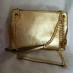 """New listing!Michael Kors bag NWT Stunning Jet Set Medium Metallic Leather Messenger Straps are leather and gold tone chain, adjustable 12""""-22"""", logo charm One outer snap pocket  Inner zip pocket, two open pockets, one key fob Polyester lining 13.5"""" X 7.5"""" X 4"""" Dust bag, pale gold color Michael Kors Bags Crossbody Bags"""