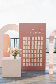 "From the editorial ""Modern Sunset-Inspired Wedding Inspiration in the Colorado Rockies."" Drawing the design together, Curate Events and Design took the escort cards, created by MBOJ Studio, to the next level with custom hollowed arches and a sweet sentiment of 'THIS DAY, THESE PEOPLE'.  Photography: @decorusfineart  #escortcarddisplay #weddingseating #uniqueweddingideas #weddingreception"