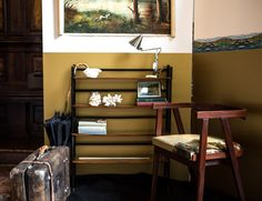 Dedicated to travel: portable bookcase from the Fourties, teak chair from the Fifties with a great upholstered with an old painting and vintage suitecase (Milano Design Week 2013)