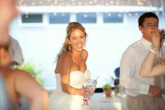 Happy Bride on her Reception in Northern Michigan at Crystal Lake Weddings!