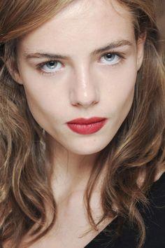 Rouge lip, soft makeup.