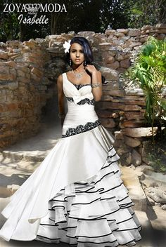 Black and white wedding gown. Our Gowns are fully boned with an Understructure, cups, and completely lined. Come with an inner elastic strap at the waist to hold it perfectly in place.