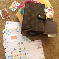 SOLD Auth pre-loved Louis Vuitton agenda with inserts! Has a place for a pen/pencil. Included will be some stickers, 2 dividers, cute bookmark tassel, to do sheets, notes sheets, & weekly calendar not dated so easily used anytime! No rips or tears & no peeling! It's pre-loved and has signs of use in the interior. Please ask questions or for more pics if serious. Thanks! I have more LV in my closet. Super cute to bundle with the monogram speedy 30 in my closet, let me know for a discount ❤️…