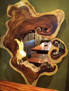 Large Monkey wood mirror frame.. wouldn't this be a awesome window from the dining room to the living room