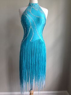 "A bright dress, full of energy. Fringe skirt adds movement while in motion. Dress has body suit and bra cups. Fits a size range from 6-10 and is best for dancers of height from 5'3"" to 5'6"""