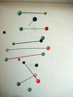 Mobile by Renilde De Peuter of At-Swim-Two-Birds via  ii-ne-kore.blogspot.com: Large, handmade  multi-colored mobile of handpainted balls. $178.