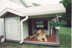 large dog house design with hanging plants...other designs on this site.