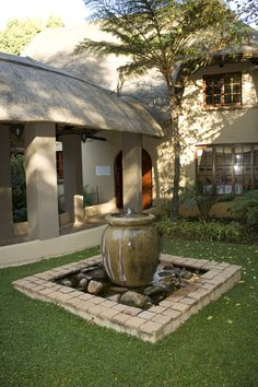 Front entrance Fountain  Monchique Boutique Guest House Muldersdrift Front Entrances, Fountain, In This Moment, Boutique, Luxury, Plants, House, Home, Water Fountains