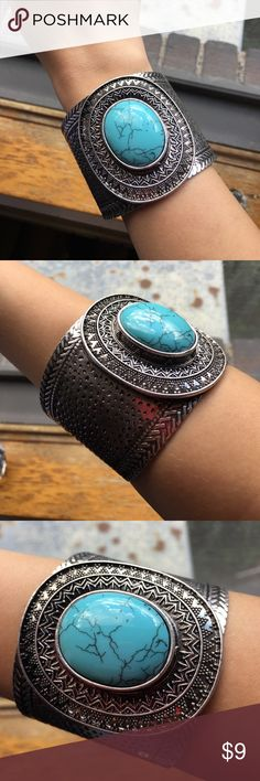 Large cuff bracelet with turquoise stone Large cuff bracelet with intricate designs and a huge turquoise stone! Never worn, however tags were removed. I adore this bracelet so much that I bought two by accident 😂 lydell nyc Jewelry Bracelets