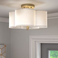 The perfect mix of simple patterns and clean-lined looks in your well-appointed and stylish space, this bold semi-flush mount adds an understated and subtle touch to your space. Featuring a drum-inspired white fabric shade with a bold quatrefoil design, this piece offers a low-key touch of pattern to your ensemble, while its glimmering brushed gold finish offers up luxe charm to the piece. Hang it up in the foyer to cast a warm glow over your well-appointed entryway ensemble, or set it in…