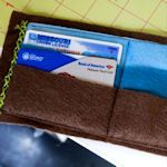 Make your own wallet!  Many a tutorial for making your ideal wallet.