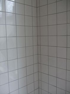 Regrouting with dark grey grout to modernise a boring - Update bathroom tile without replacing ...