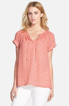 Free shipping and returns on Caslon® Cuffed Sleeve Peasant Top (Regular & Petite) at Nordstrom.com. An easy peasant top cut from a lightweight woven fabric with a soft medallion print is fashioned with cuffed short sleeves and ties hanging from the smocked split neckline.