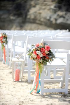 Wedding Chair Flowers with hanging ribbons. Lanterns down aisle. Aisle Decor. Coral, aqua blue, peach. Roses, lisianthus, hypericum berries, dusty miller, eucalyptus. Beach Wedding. Florals by Jenny// Images © Gavin Wade Photographers - www.gavinwadephoto.com