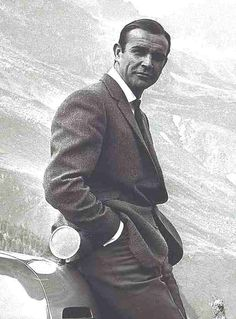 Sean Connery http://www.solarnavigator.net/films_movies_actors/actors_films_images/Sean_Connery_suited_Goldfinger_Aston_Martin.jpg