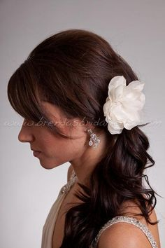 I want this for my wedding, except all down with the flower instead of in a pony to the side.